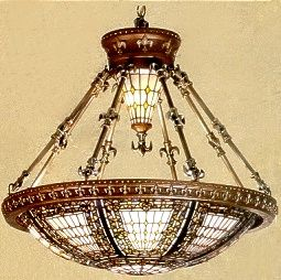 """Fleur-de-lis Art Glass Chandelier: Fleur-de-lis meaning """"flower of the lily"""" a symbol of royalty signifying light, life, and perfection. From the Tiffany Reproductions Collection."""