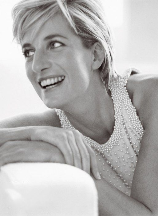 Princess Diana in a sarong-inspired Catherine Walker gray silk gown, featuring a halter bodice with subtle sequins and faux pearls.
