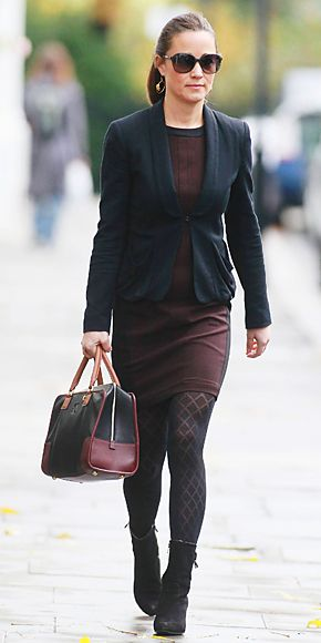 Pippa teamed her Zara dress with a black blazer and ankle boots for her morning commute.