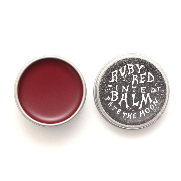 A ruby flaming opium poppy natural red tint for your lips, made from all natural ingredients no less. This ruby red lip balm leans on the side of a deep orange, and will moisturize and protect the lips while giving them that 'just ate a cherry popsicle' pout.