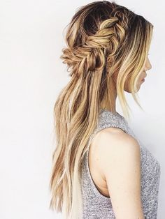 Leave your hair down and braid a crown around just the back of your head. So cute. Secure the look with a great hair spray.