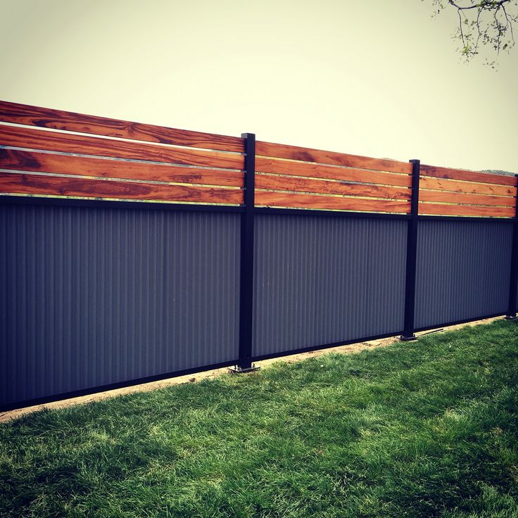 Custom Privacy Fence. Built Out Of Metal Post, Tiger Wood, And Corrugated  Metal