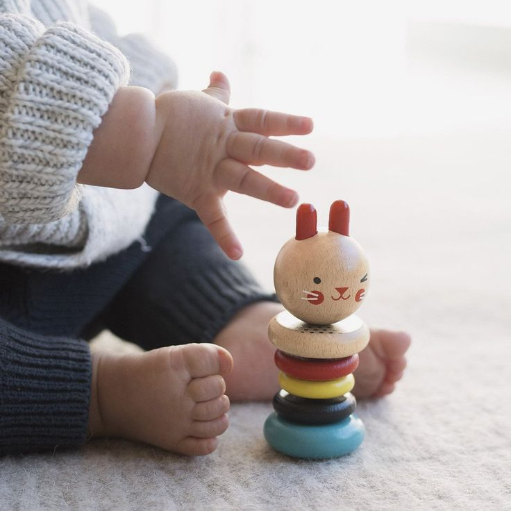 This colorful bunny rattle makes a soothing click-clack sound when gently shaken. Five smooth beech wood rings are perfect for little hands to practice clutching and grasping. Vibrant color and patter