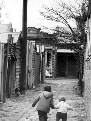 July 1970: An inner city back street that was home to many of Melbourne's poor. The original caption written for this photograph defined the poor as widows, the unemployed, unmarried mothers and the derelict. Picture: Herald Sun Image Library