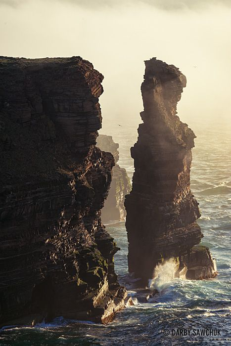 North Sea waves crash against a sea stack at Duncansby Head in Caithness in the north of Scotland.