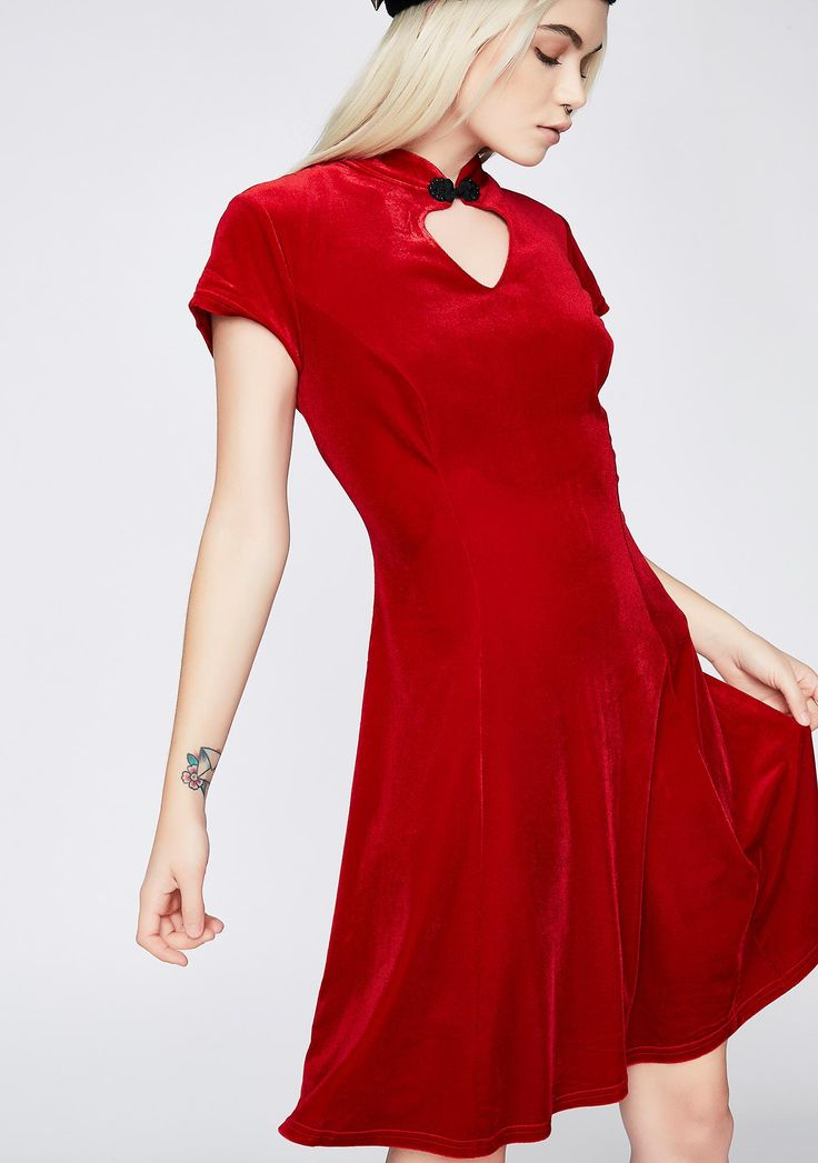Hell Bunny Ruby Mika Mini Dress cuz your heart is on display. This red velvet dress has a heart cut-out at the neck, short sleeves, and a flowy skirt.