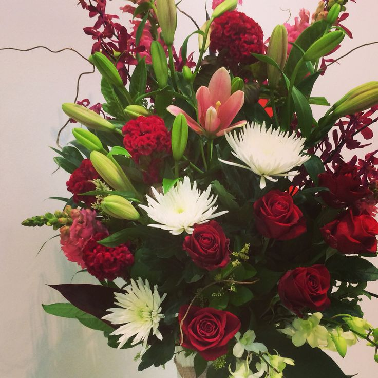 Too big for the picture! Mega romantic arrangement James storii orchids, red roses, white disbuds, pink asiatic lillies and white orchids