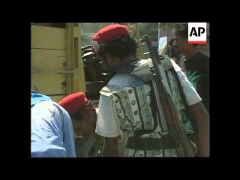 EAST TIMOR: LIQUISA: RETREATING MILITIA BURN HOUSES