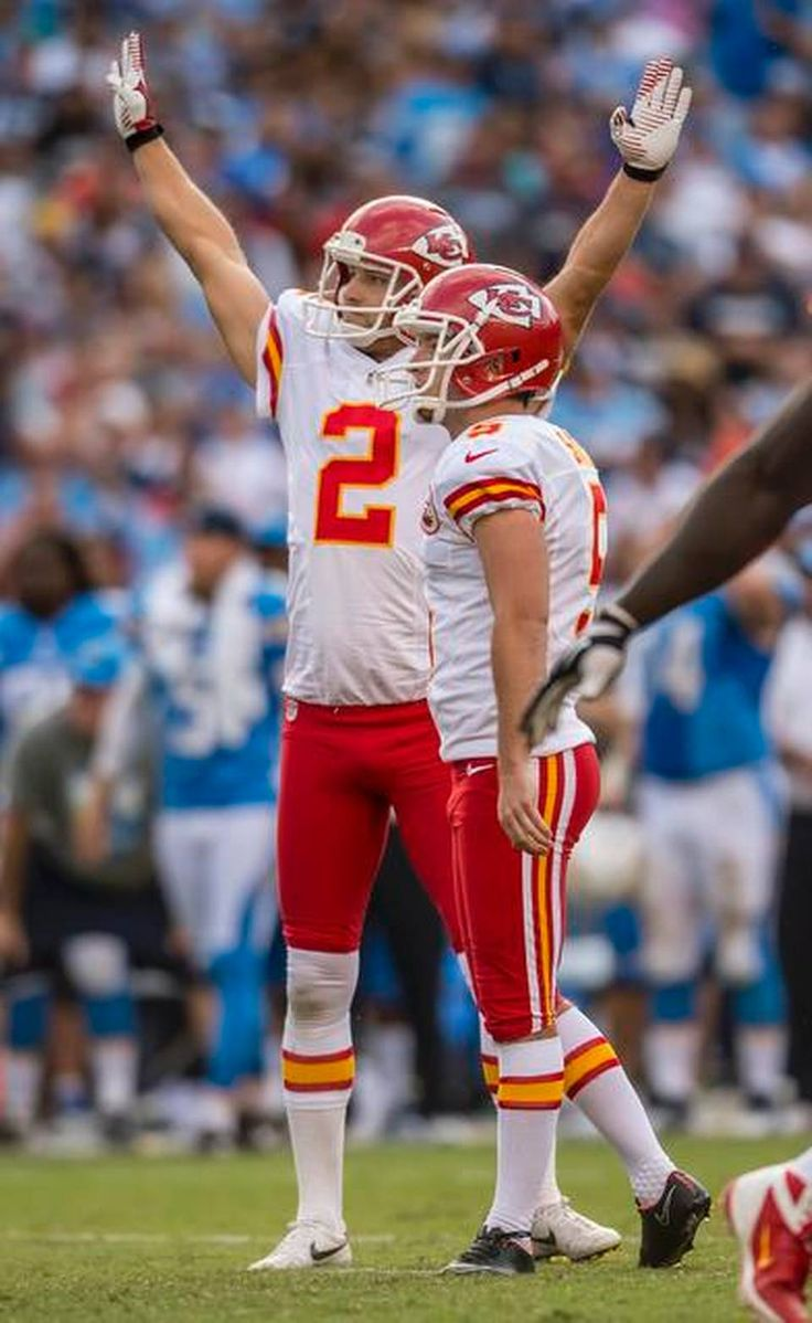 Kansas City Chiefs kicker Cairo Santos (5) watched his 48-yard field goal sail through the uprights to win the game with :21 seconds left against the San Diego Chargers, 23-20, at Qualcomm Stadium in San Diego, CA on October 19, 2014. Kansas City Chiefs punter Dustin Colquitt (2) celebrated next to Santos.