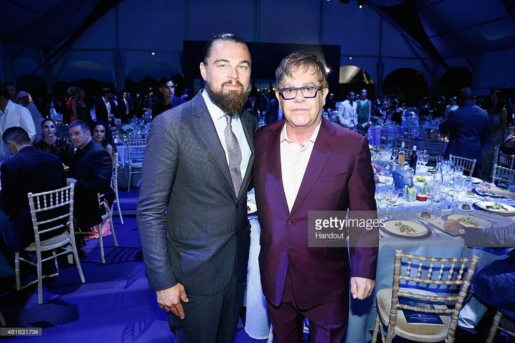 Leonardo DiCaprio and Elton John pose during the Dinner and Auction during The Leonardo DiCaprio Foundation 2nd Annual Saint-Tropez Gala at Domaine Bertaud Belieu on July 22, 2015 in Saint-Tropez, France.