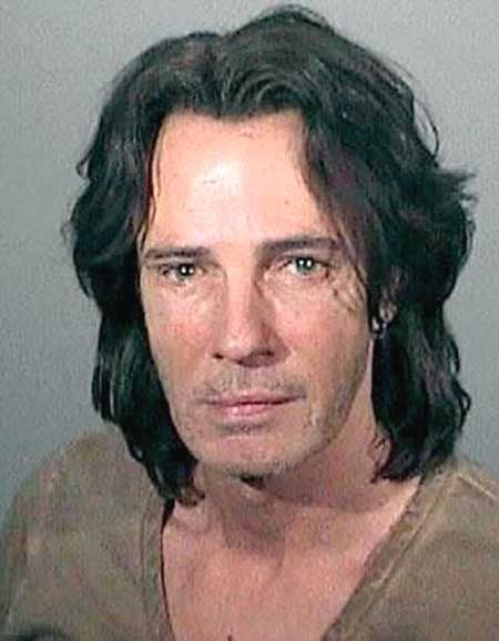 """Singer Rick Springfield was arrested by the Los Angeles County Sheriff's Department in May 2011 for suspicion of drunk driving. The 1980s pop star, 61, was pulled over by officers in Malibu along the Pacific Coast Highway. A Breathalyzer test showed his blood alcohol content at .10. The """"Jessie's Girl"""" singer was then booked into jail where he posed for the above mug shot before posting $5000 bail."""