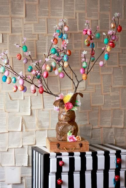Display colorful Easter eggs on a #DIY tree, complete with an upcycled paper mache bunny as its base.