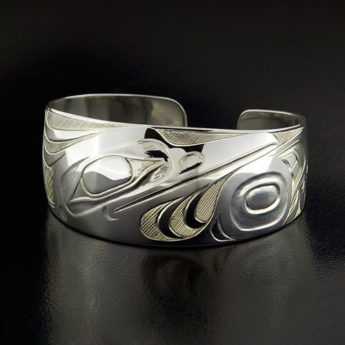 "Kingfisher Sterling Silver Bracelet by Ernest Swanson, Haida. Hand-carved, 1"" x 6"", available for $900.00 CDN."