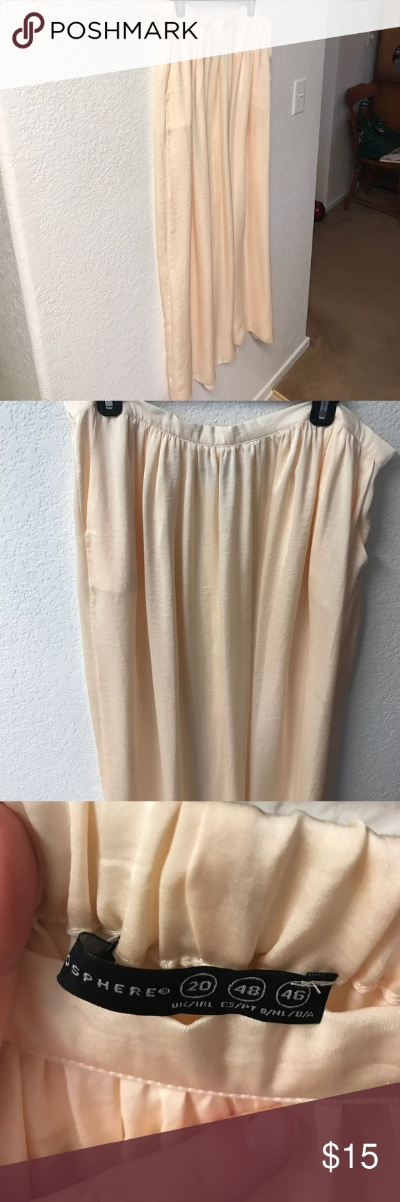 Beige Maxi Skirt Beige silk - like maxi skirt. The beige is more of a cream color. Never worn. Part of the waist is elastic. There are pockets. It is a size 16 in the USA. Primark is a U.K. brand. Primark Skirts Maxi