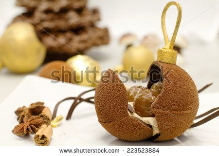 christmas chocolate bauble with delicious stuffing against  sweets background - stock photo