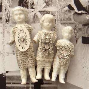 … antique frozen charlotte dolls with collage elements and vintage bling