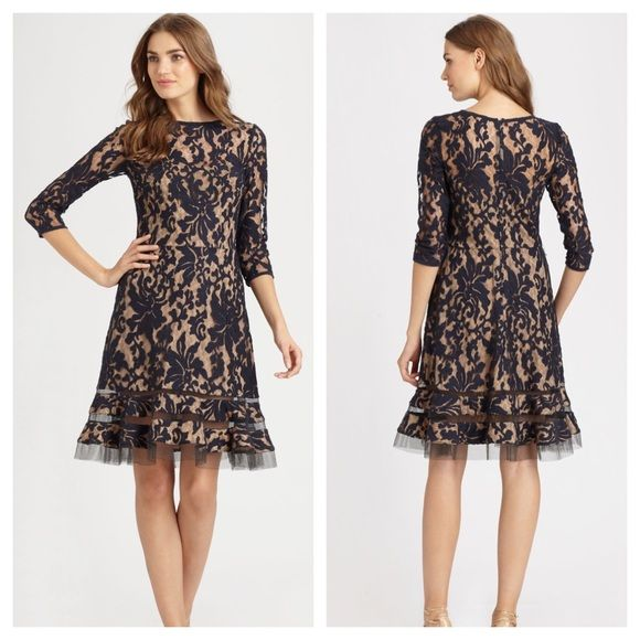 "Tadashi shoji Navy is still a favorite this Season, and Tadashi Shoji uses his signature illusion detailing in navy to fine effect. Nude underlay highlights the lace pattern; neck and sleeves maintain sheer sophistication. Sheer lace over satin underlay. Round neckline. Three-quarter sleeves. Fitted bodice with attached grosgrain ribbon band at natural waist. A-line skirt with illusion detail at hem. Approx. 40""L. Cotton/nylon with polyester lining; dry clean only. Imported. Never worn…"