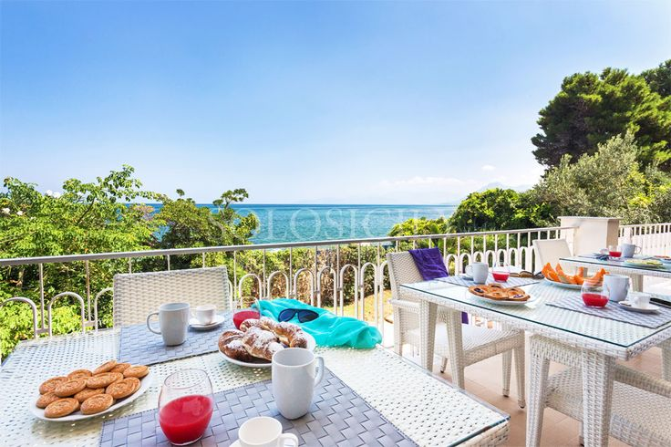 Lory's terrace with sea views and direct beach access.