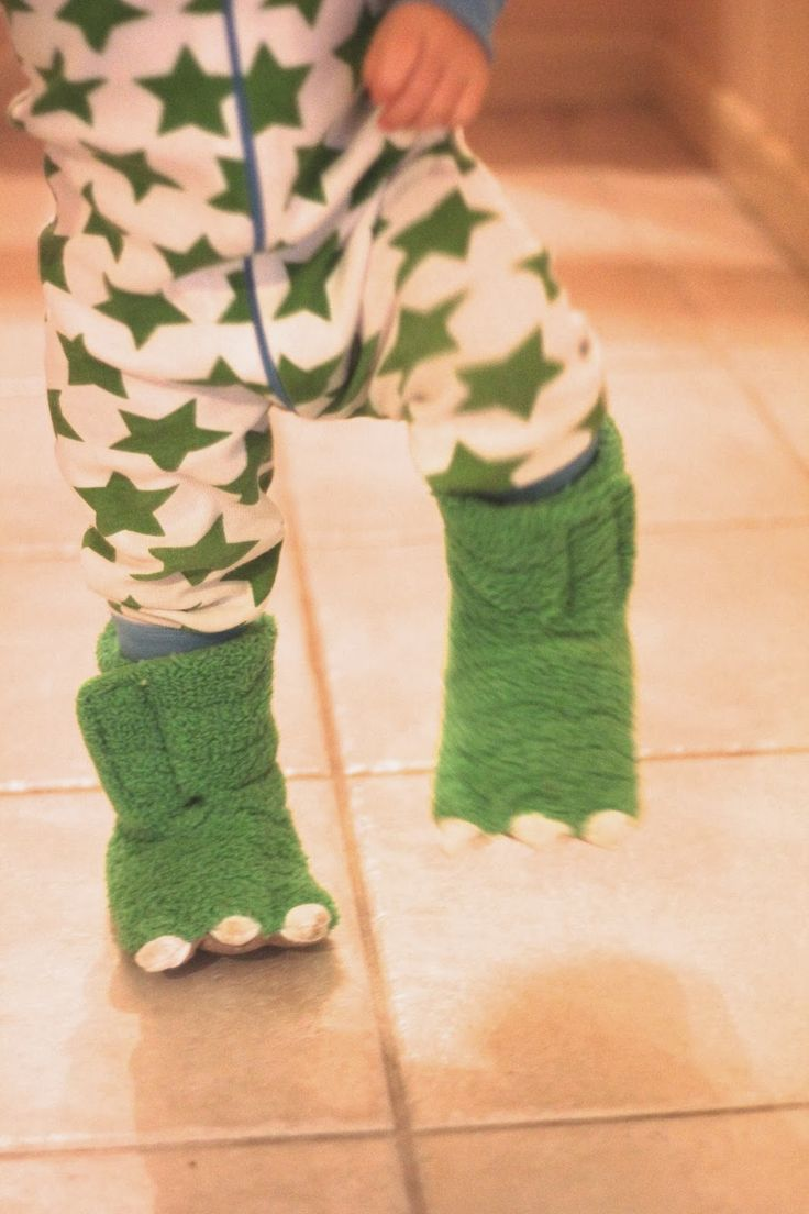 Monster dino feet. (Carter's dino slippers)