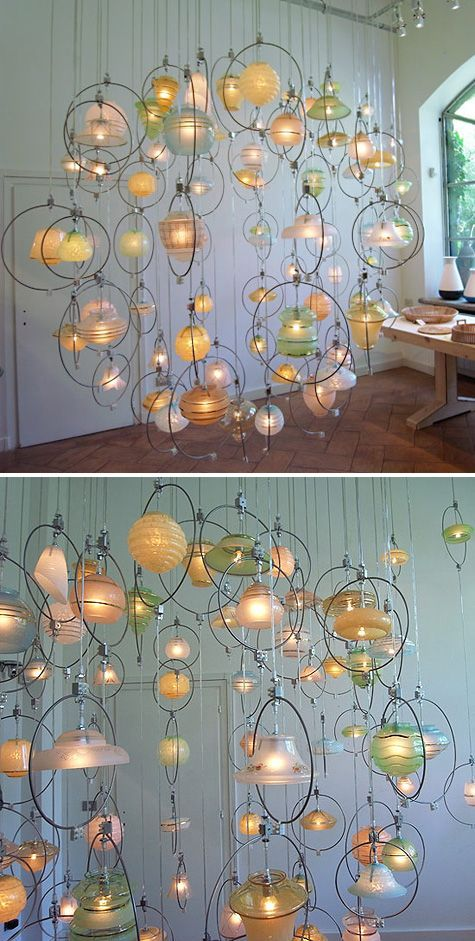 This idea, more simplistic, could be stunning in windows if the various glass was painted with phosphorescent paint and glowed at night! (instead of lights)