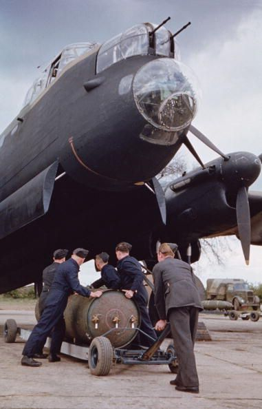 loading a 400 lb Cookie bomb into a Lancaster bomber.