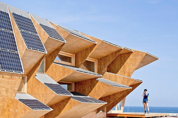 Looking out over Barcelona's sunny seafront, the Endesa Pavilion, Solar House 2.0 is constructed with a solar roof to optimise from the suns energy.
