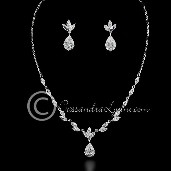 A single teardrop jewel accents a marquise jewel vine in this bridal jewelry design. Earrings are approximately 1 inch long, post backs, the necklace is 16 inches with a locking clasp.