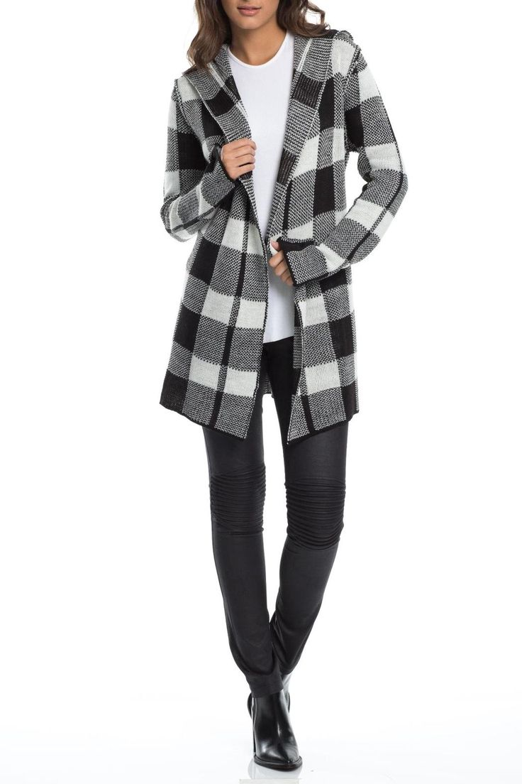 Black and cream plaid long sweater coat has a hood and long sleeves with a bell shaped bottom. Long sweaters are all the rage this season, so pair this sweater with your favorite boyfriend jeans and a shoe boot for an on trend look.   Plaid Coat Sweater by Elan. Clothing - Sweaters - Cardigans Wyoming