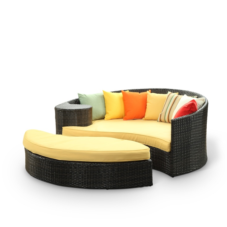 Taiji Outdoor Wicker Patio Daybed with Ottoman in Brown with Orange Cushions Harmonize inverse elements with this radically pleasing daybed set. Seven plush throw pillows adorn Taiji's thick all weather orange cushions allowing for the splendorous blending of mediating elements. Find the key to attainment as you bask in a charged and unified landscape of expansiveness.