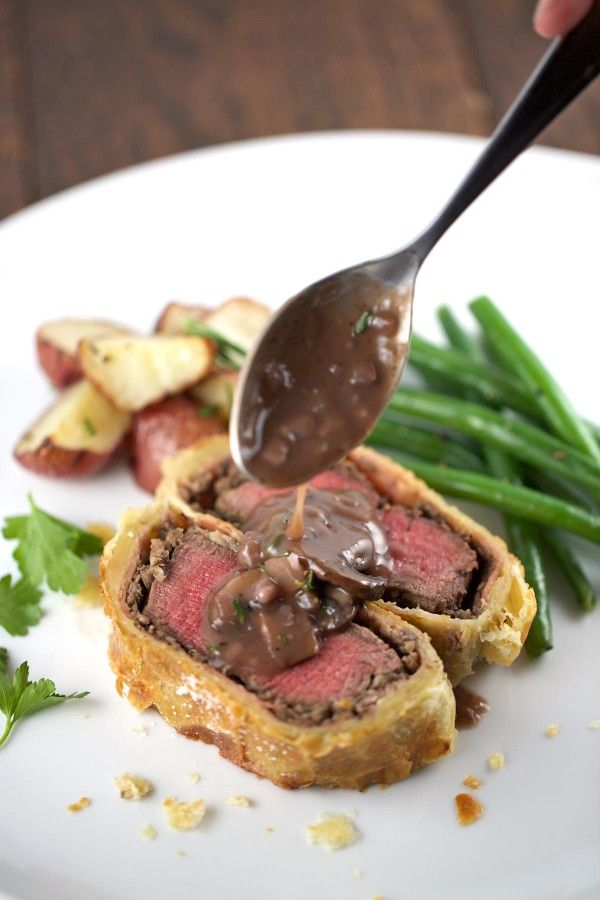 Adding red wine mushroom sauce over individual beef wellington serving | jessicagavin.com