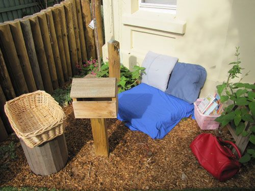 Cosy corner outdoors, throw in some story books and teddies! Maybe even a tea set. I wanna play :-)