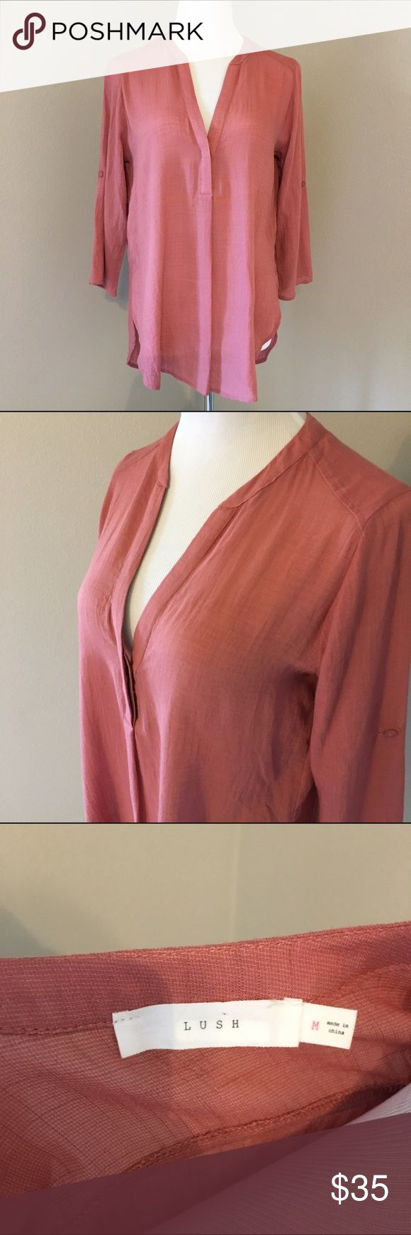Tunic Top Transitional sleeves and deep v neck line. Hi-low hem. In excellent used condition. Dusty Rose color. Measurements only by request. Lush Tops Tunics