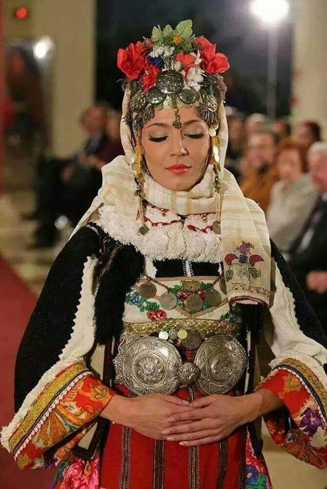 Bulgarian girl in a traditional costume: