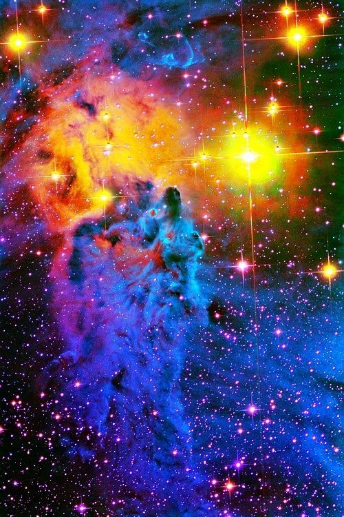Gorgeous pic of outer space, looks like a lady in a big coat.