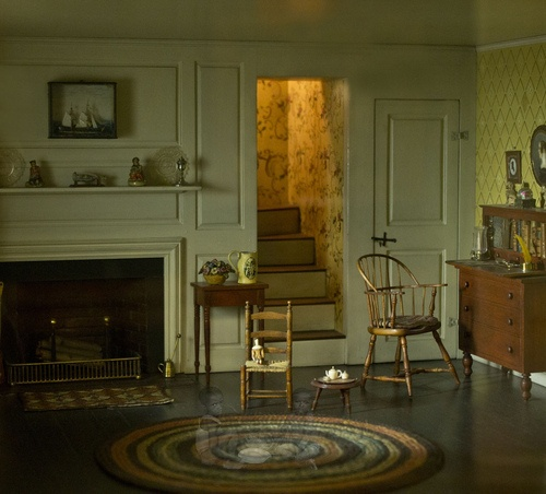 Windsor chair. (Looks like miniatures)   See the two wee ones on the braided rug? <3