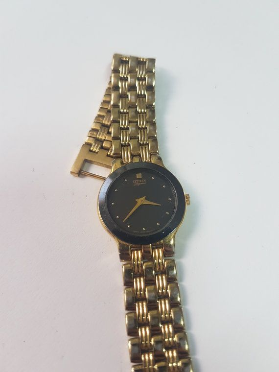 Citizen - Mens Gold Tone - Vintage Japan made - Wrist Watch Run Order - Vintage Watch -Ladies Citizens Black Gold Dial Quartz Watch - 1970s  This is a womans Citizen Quartz wrist. It has a gold metal case and band and black face. Very good condition and can be handed as a gift to a lady the very first moment of receiving it ! At 29.99$ this is bargain and will satisfy your needs! Please feel free to ask for anything else.  Ladies Citizens Black Gold Dial Quartz Watch. Model Case Back is…