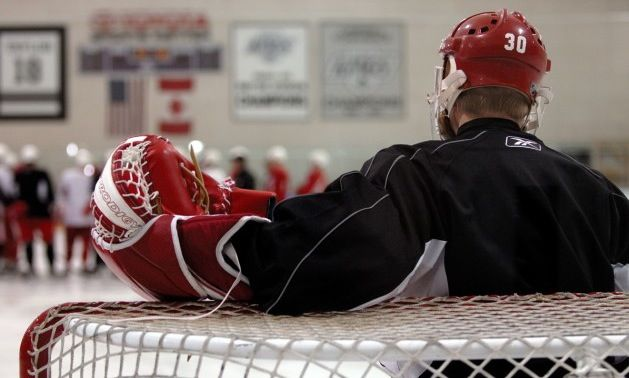 Chris Osgood taking a break in the net #detroit #osgood #nhl #goalie #practice #cooper #cage #mask #combo #redwings