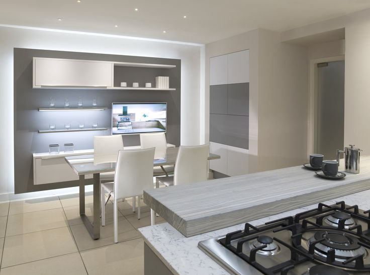 One of our consultation areas that displays media units and dining room furniture that you can add to your kitchen design. #mediaunits #tvareas #dining #kitchens #design #showroom