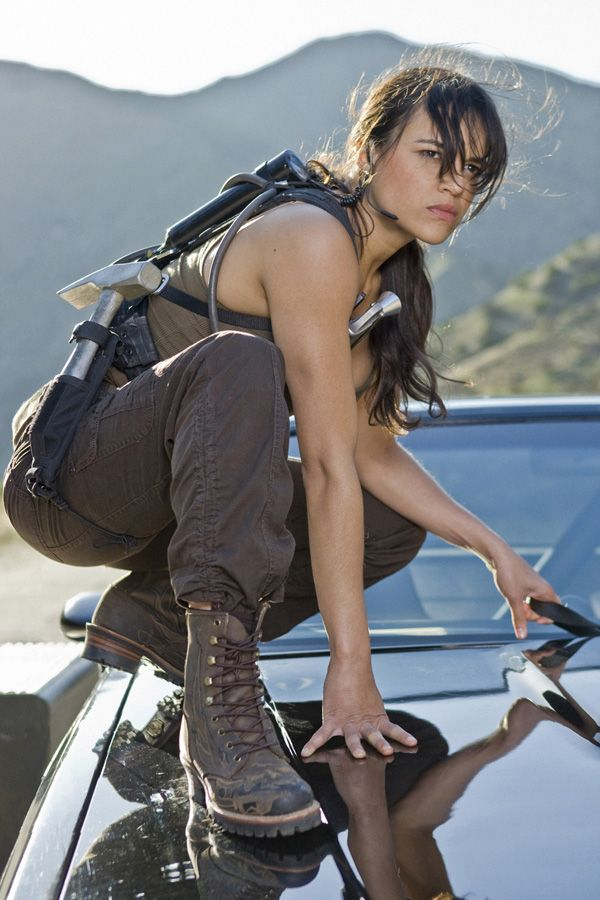 Ms. MICHELLE RODRIGUEZ --- in Fast and the Furious. She is strong AND beautiful.