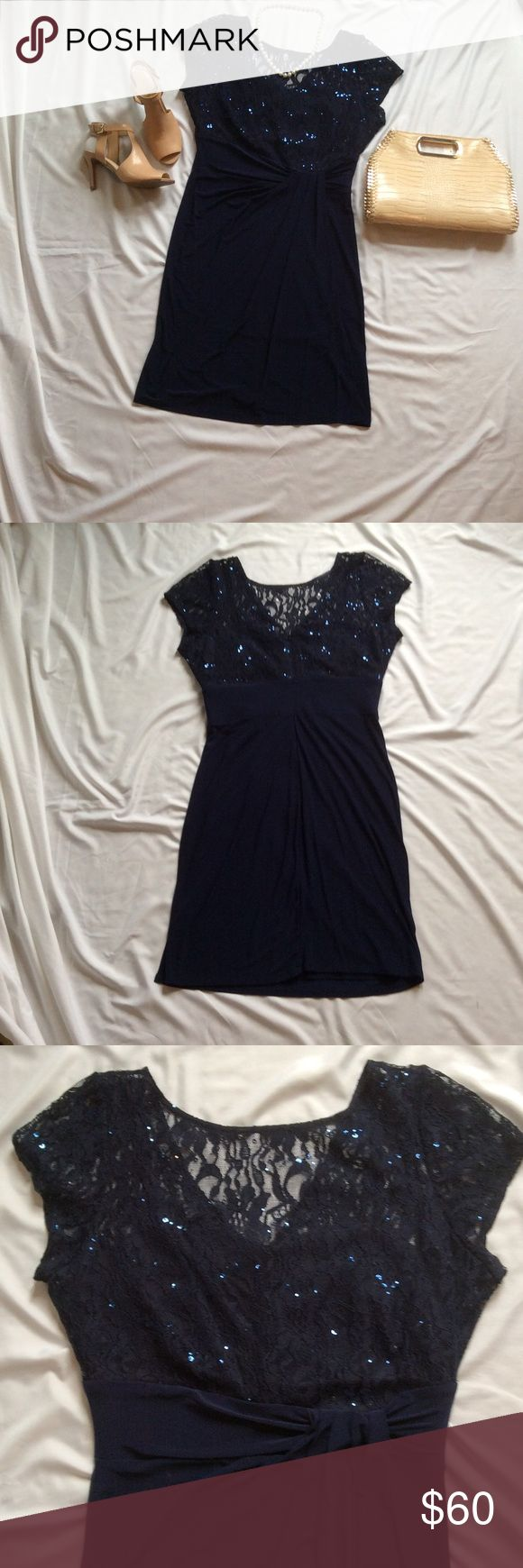 """Gabby Skye Navy sequins and lace Cocktail Dress I wore this dress once to a wedding.  I was newly pregnant.  Maybe worn for 2 or 3 hours tops.  It has a boat neck and cap sleeves with a v-cut in the back.  Zipper runs up the back from bottom of v cut to tail bone.  This dress is fully lined with a little slip sewn in that runs the full length of the dress.  Measurements laying flat: Bust 21"""", sleeve opening 7"""", Waist 16"""", length shoulder to hem 40"""".  Material is very stretchy (so flattering…"""