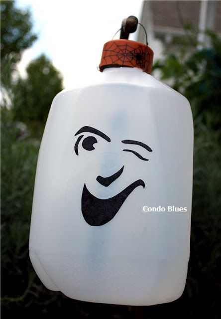 How to Make Solar Milk Jug Ghost Luminaries - at least there's a good use for useless solar garden lights!