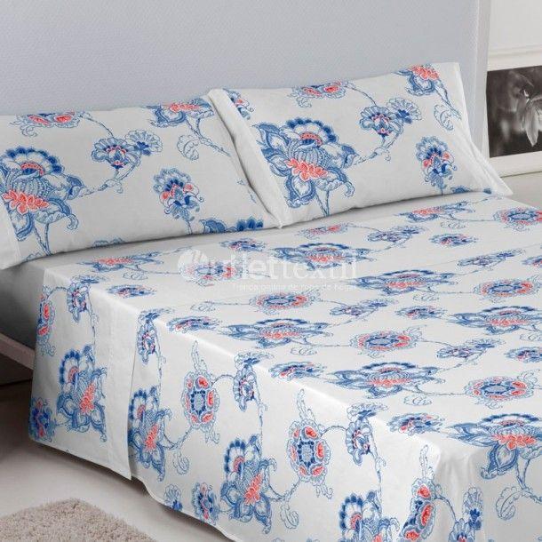 Juego de Sábanas 100% Algodón ALMA Es-tela. Este diseño está formado por un original entramado de flores de color azul eléctrico con el corazón en naranja. Ideal para espacios diáfanos donde no se busque contraste de tonalidades.