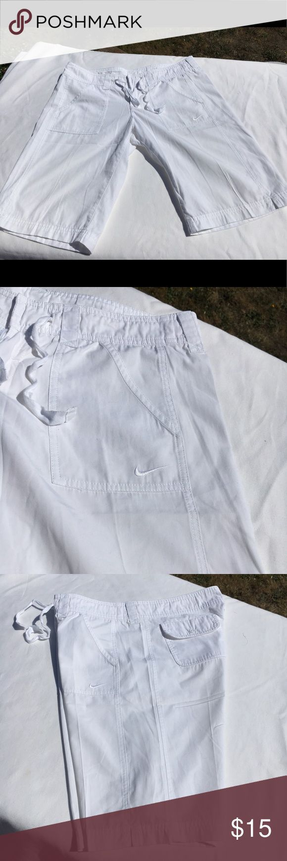 ☀️Nike bright white shorts In good shape except I did cut the Nike tag out of the inside because it showed through the shorts when wearing...be aware when wearing in the rain or in humid conditions they can be seen thru.  I do believe that they are size medium but will post measurements later Nike Shorts