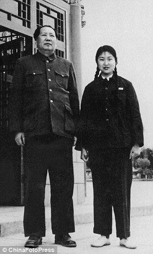 Chairman Mao Zedong poses with his daughter Li Min at Yingxun Pavilion of Zhongnanhai in 1953, in Beijing, China