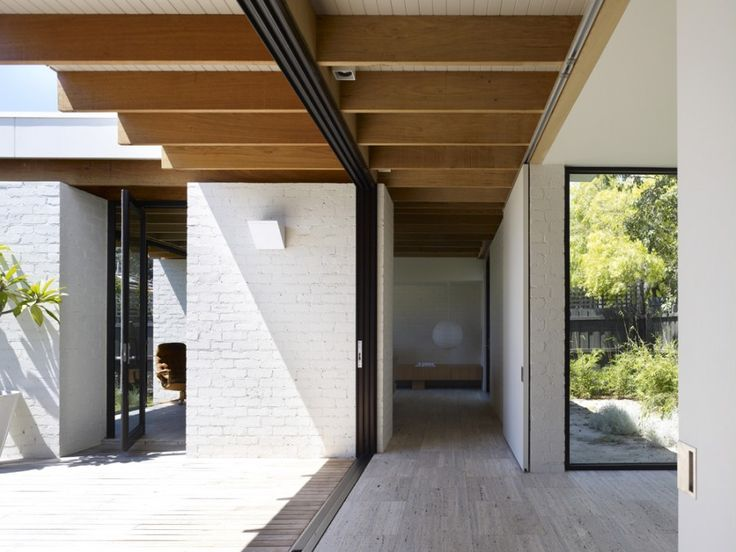 Hampton house 2 by Kennedy Nolan architects. Stone, wood & white brick. Bringing the outside in.