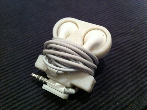 Apple Earbud Holder made with 3d printer. I have made several of these. They are a great idea for carrying the Earbuds in your pocket. I stopped using them in the car as it just took too long and was too dangerous to try to unwind or wind while driving.