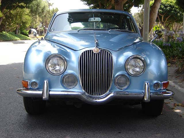 1966 Jaguar S type in silver-blue metallic exterior.