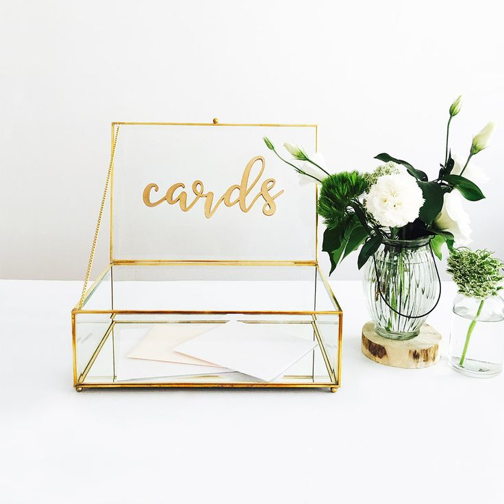 gold glass wishing well with cards sign