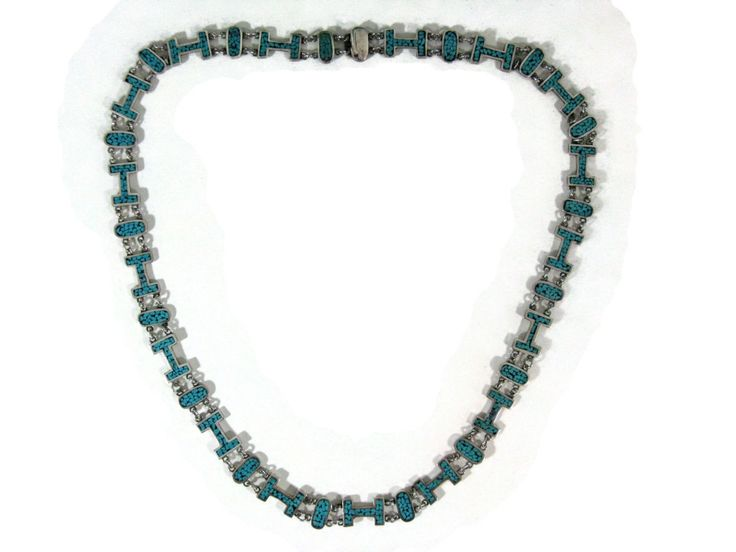 """VINTAGE JACOPO BROS ARTE EN PLATA .925 NECKLACE 30""""l: Vintage 20thc, Taxco Mexico, Jacopo Brothers, Arte En Plata. Opera length necklace comprised of oval and 'H' form links with chip turquoise and connected with round, soldered jump rings, impressed, 'ARTE EN PLATA' Taxco Mexico 114, 30""""l, 104g. Available @Auction with www.Rare-Era.com. Contact is: info@rare-Era.com"""
