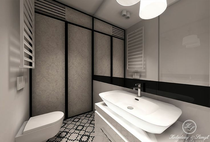 Black and white, elegant bathroom with mosaic tile by Kolodziej & Szmyt.